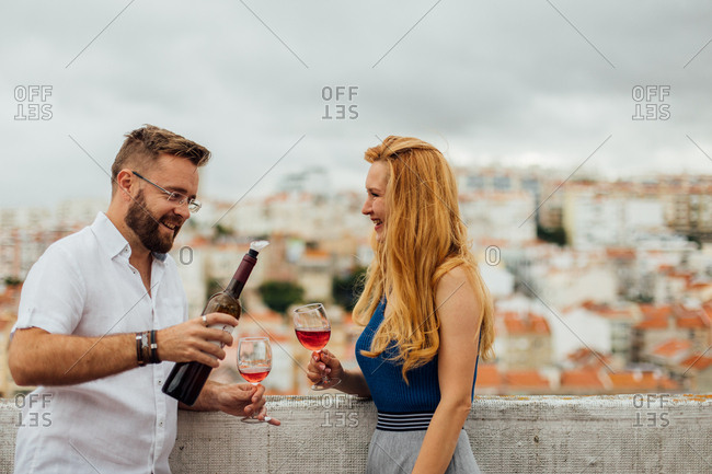 Pouting Wine on a Rooftop