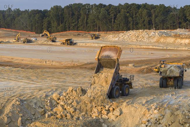 Stone Mountain, Georgia, United States - July 25, 2019: Unloading Dirt, Construction Site, Stone Mountain, Georgia
