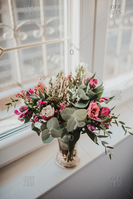 Beautiful bouquet of roses on a window ledge
