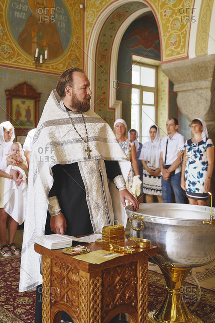 Krasnoyars, Russia - August 4, 2019: The priest stands before the baptismal ceremony and looks at the parishioners at a Russian Orthodox Christian church