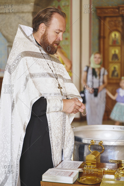 Krasnoyars, Russia - August 4, 2019: The holy father says a prayer at a Russian Orthodox Christian church