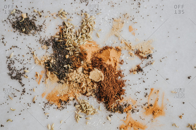 Layflat image of spice mixture on white marble