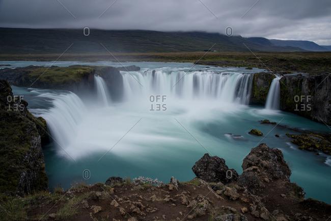 Long exposure of flowing waterfall in Iceland
