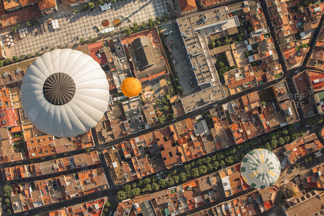 Aerial view over balloons floating above city in Spain