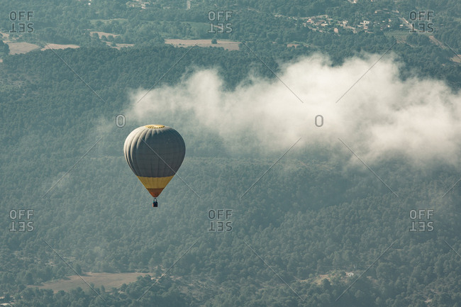 Hot air balloon floating over rural Spain