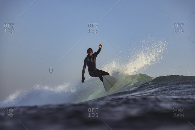 Surfer on a wave, Bali, Indonesia