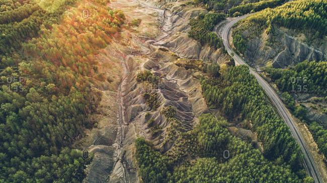 Bird's eye view of dry lake by highway in Monte Perdido, Spain