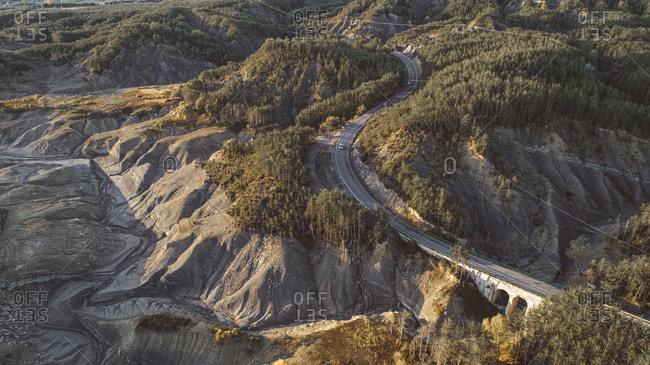 Aerial view of dry lake and winding road in Monte Perdido, Spain