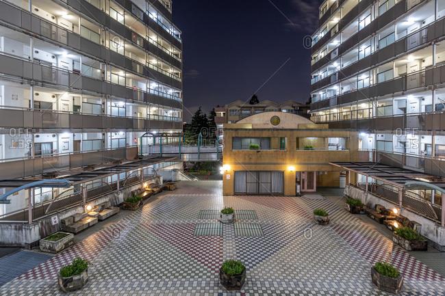 Tokyo, Japan - October 28, 2019: Modern building exterior at night