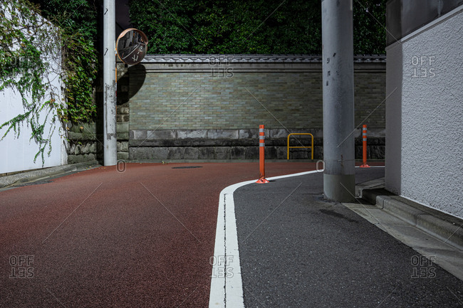 Tokyo, Japan - October 26, 2019: Red winding pavement on street in downtown Tokyo