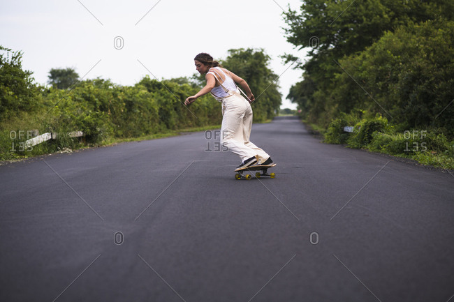 Young Woman Skateboarding in Summer