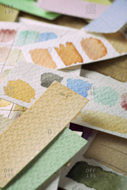 Watercolor test cards on a table.