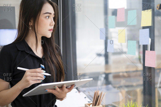 Young businesswoman using tablet searching information marketing