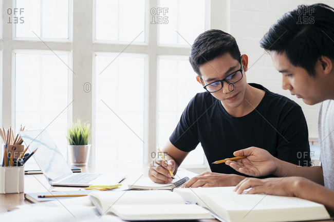 Young men studying for a test or an exam.