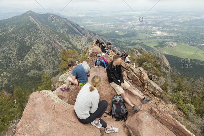 United States, Colorado, Boulder - May 27, 2019: Hikers enjoy views of Boulder, Colorado from Bear Peak summit
