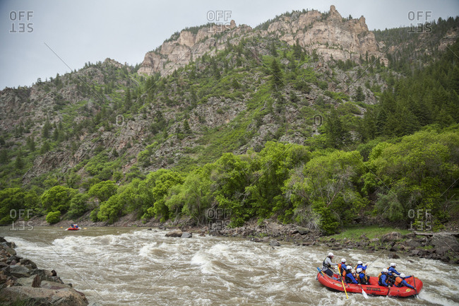 United States, Colorado, Glenwood Springs - June 3, 2019: Rafters paddle the Colorado River through Glenwood Canyon, Colorado