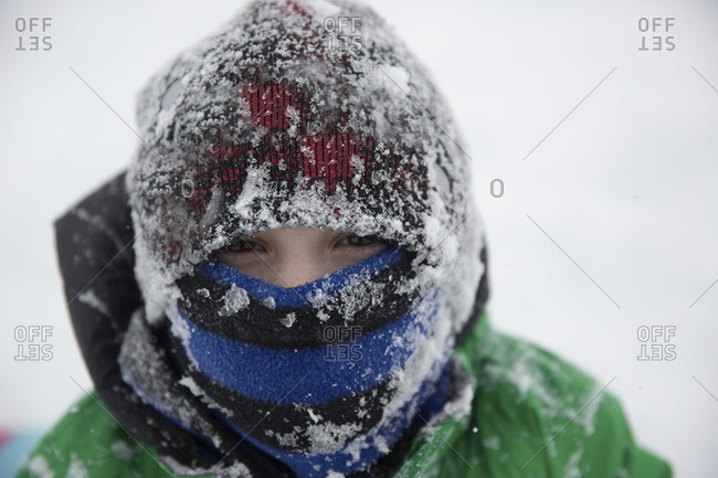 Portrait of teenage boy wearing frozen warm clothing during winter