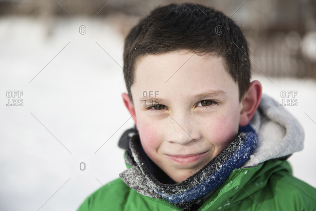 Portrait of confident teenage boy wearing warm clothing during winter