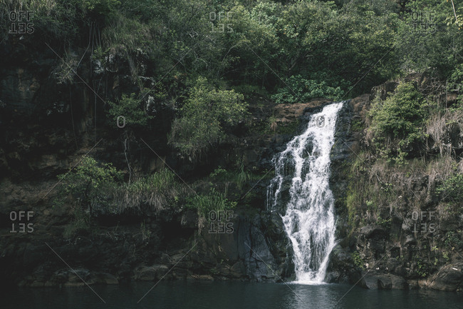Scenic view of waterfall over rock formations