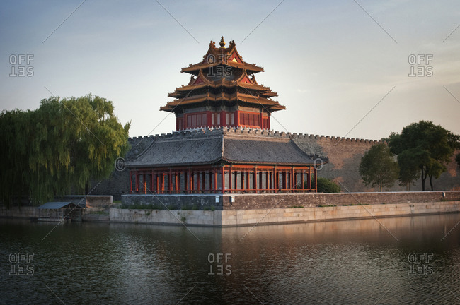 Tiananmen gate by river against clear sky