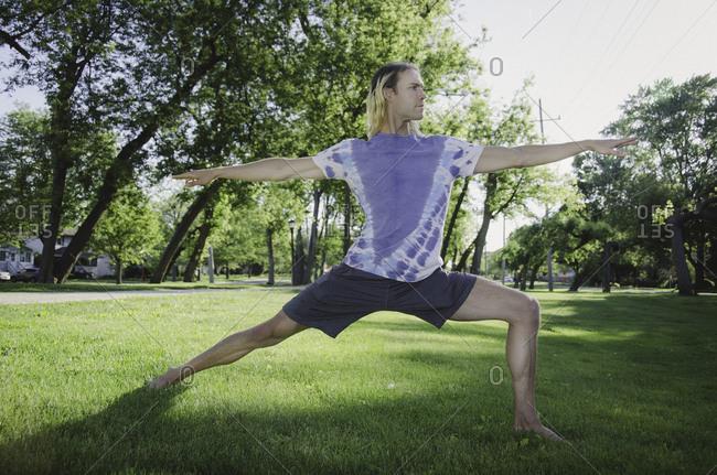 Full length of man exercising at park