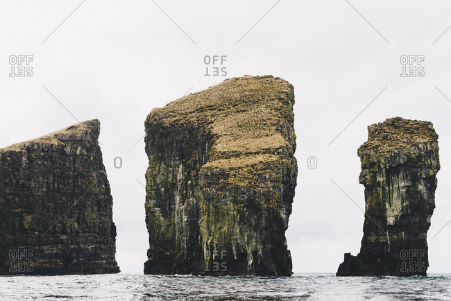 Scenic view of stack rocks in sea against sky