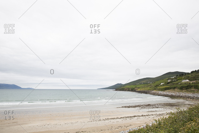 Scenic view of Inch beach against cloudy sky