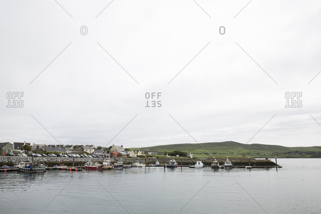 Ireland, Dingle - June 22, 2015: Scenic view of lake by town against cloudy sky