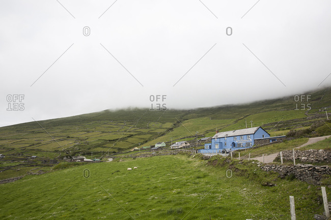 Ireland, Tralee - June 22, 2015: House on landscape against foggy weather
