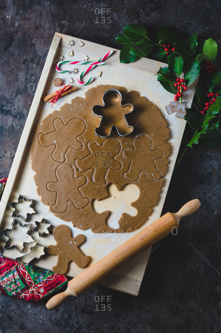 Overhead view of gingerbread cookie dough, molds and rolling pin