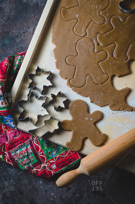 Overhead view of gingerbread cookie dough, cookie cutters and rolling pin