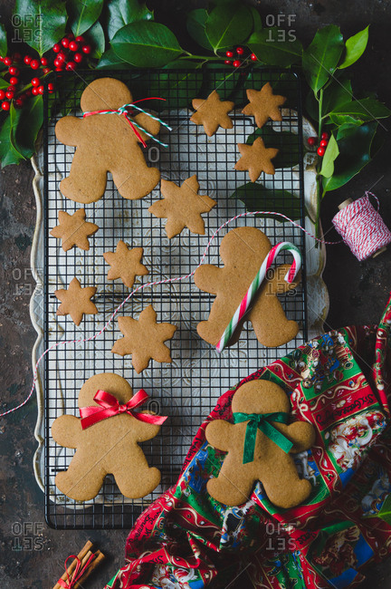 Baked gingerbread cookies on a cooling tray in festive surrounding