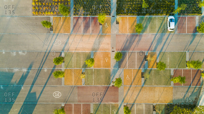 Aerial view of a colorful parking lot during the morning, Pubol, Spain.