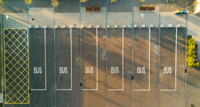 Aerial view of bus parking lot during the morning, Pubol, Spain.