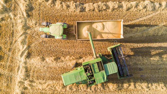 Aerial view above of machine harvesting agricultural field, Girona, Spain.
