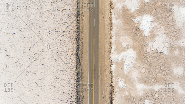 Aerial view of road crossing Salinas Grande, touristic attraction, Argentina.
