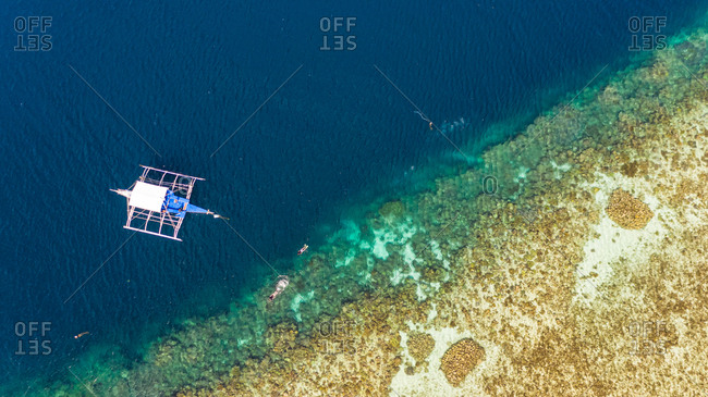 Aerial view of traditional boat near Starfish island, Philippines.
