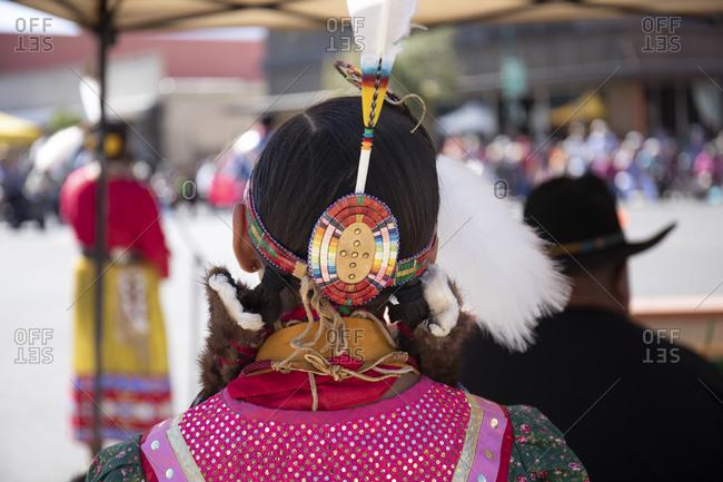Rear view of a female dancer watching an Apache festival, Globe, Arizona, USA
