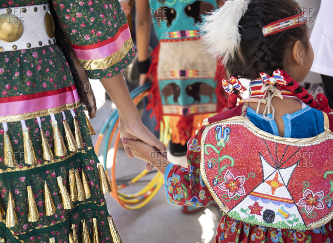 Mother and daughter preparing to go out on stage and dance at an Apache festival, Globe, Arizona, USA