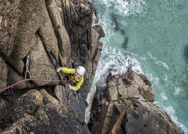 UK- Cornwall- woman climbing on Commando Ridge