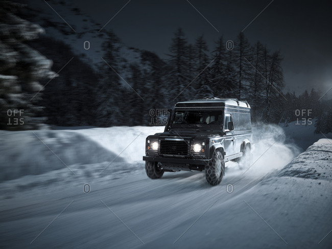 Austria- Tyrol- Stubai Valley- off-road vehicle in winter at night