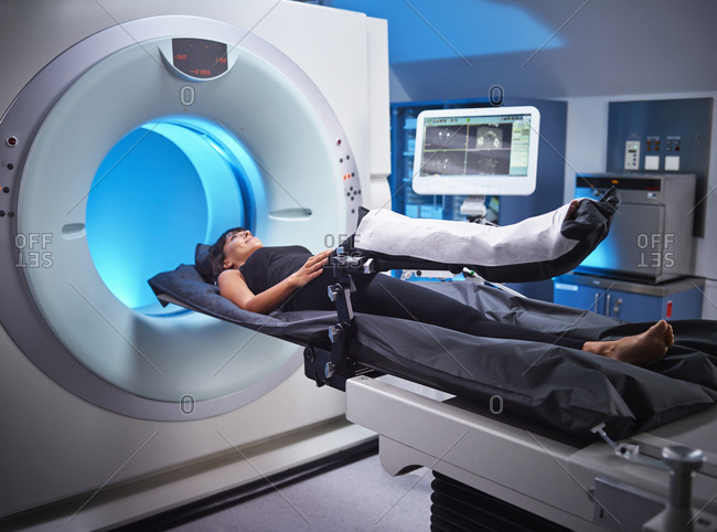 Woman having an MRI examination in hospital