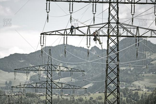 Installer during installation of high-voltage power line