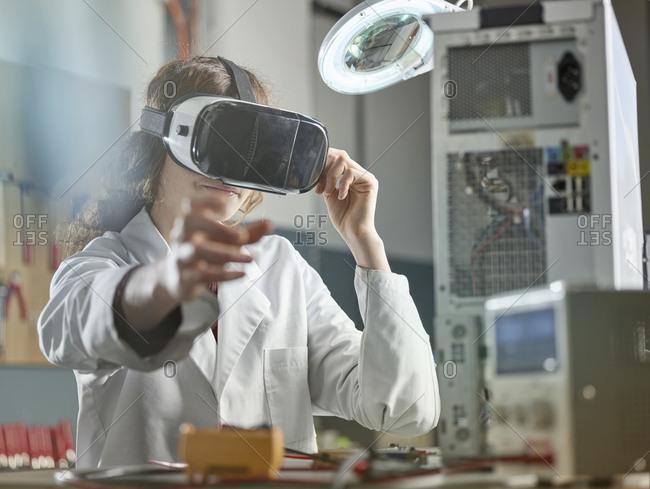 female engineer using virtual reality headset