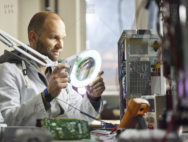 Technician working in electronic laboratory