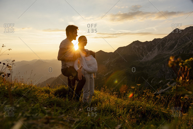 Germany- Bavaria- Oberstdorf- family with little daughter on a hike in the mountains at sunset