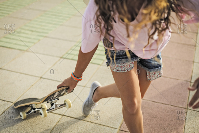 Girl with skateboard- copy space