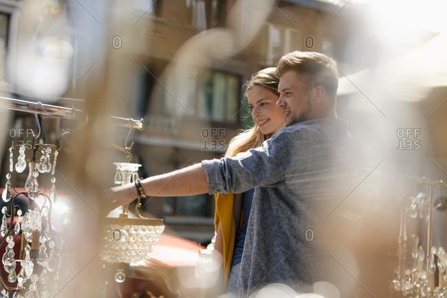 Belgium- Tongeren- happy young couple on an antique flea market