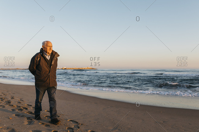 Senior man strolling at the beach