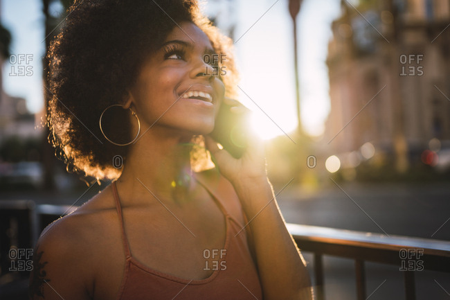 USA- Nevada- Las Vegas- portrait of happy young woman on cell phone in the city